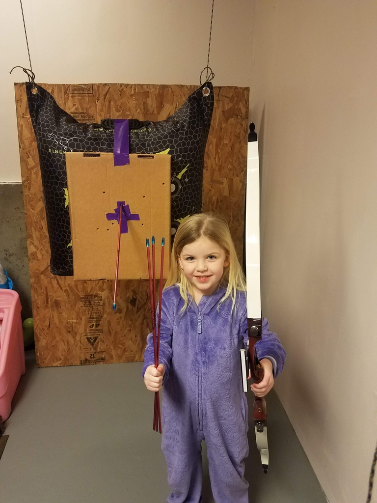 Kindergartener, Taylor, has learned how to shoot with a bow and arrow!